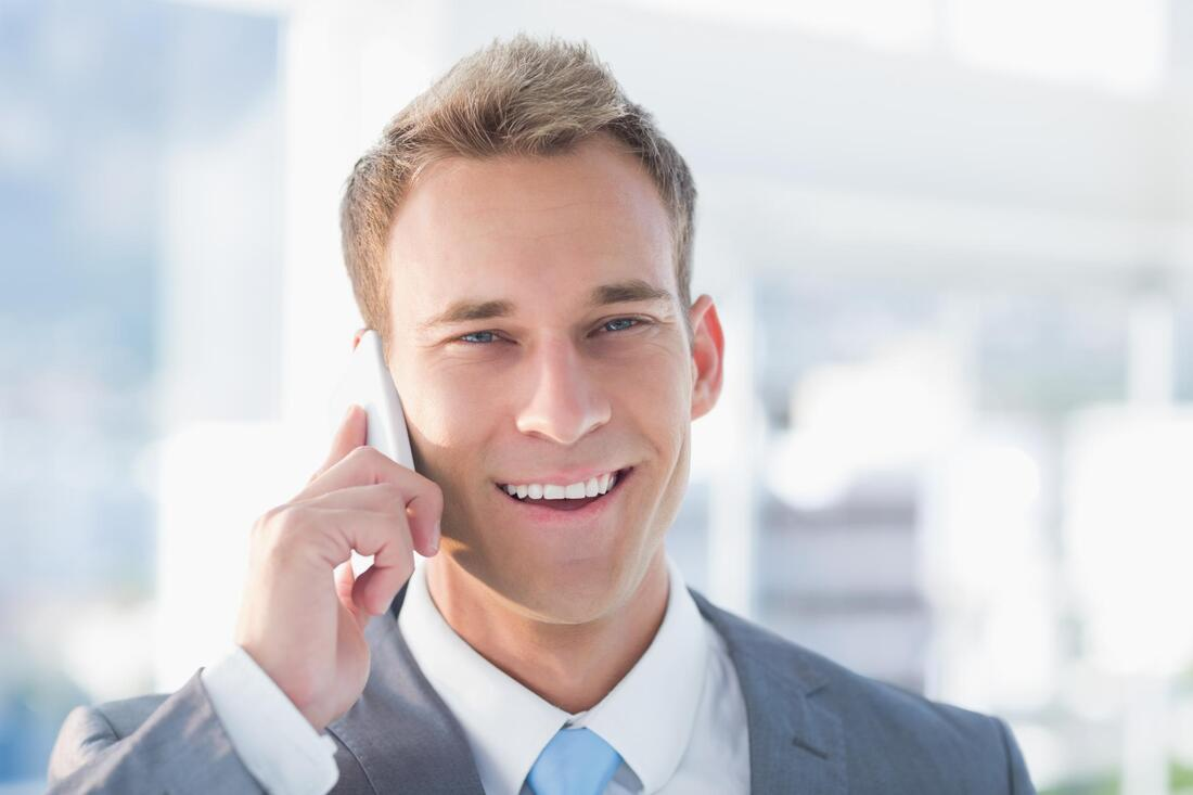 Picture of our salesman receiving a call about security guard services from a client.